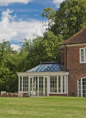 Conservatory With Cambered Arched Door Design In Berkshire.