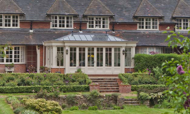 Traditional Conservatory With Bi-Folding Doors In Surrey.