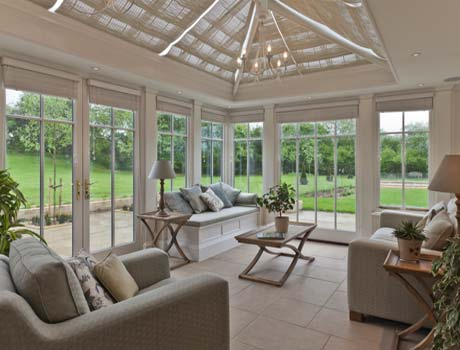 Conservatory Sitting Room With Full Length Panels.