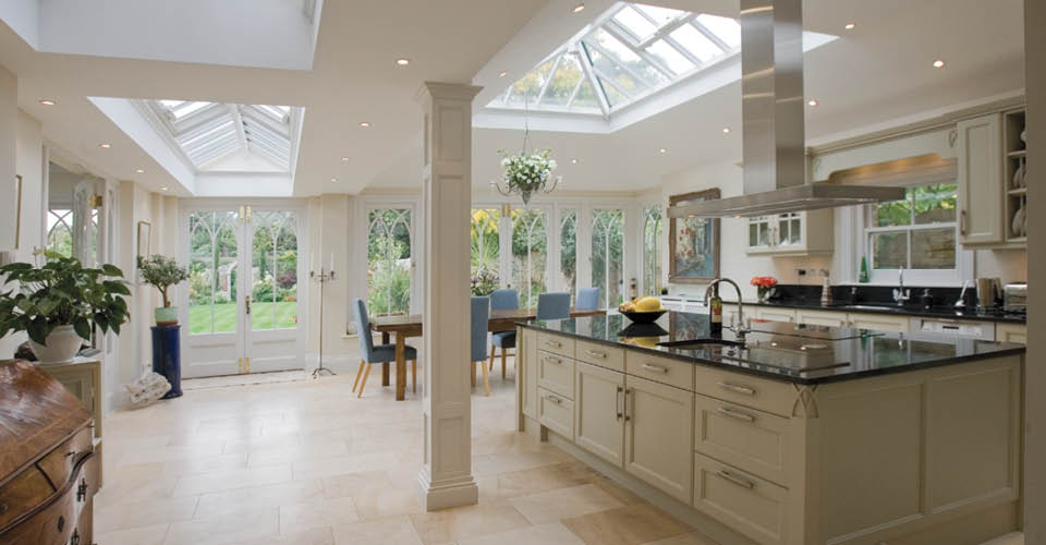 Unusual open plan conservatory provides a kitchen, dining and living ...