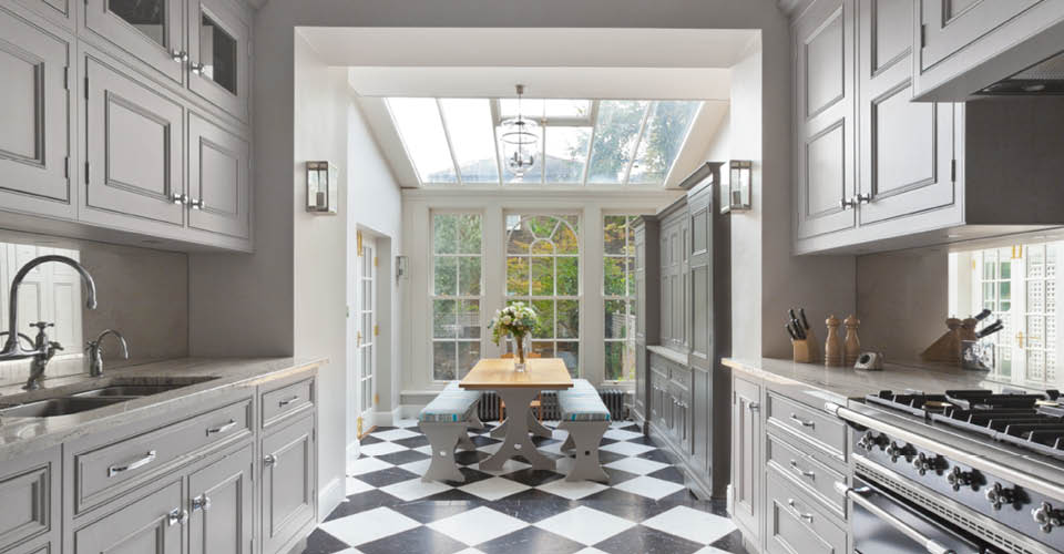 This kitchen conservatory with a decorative gable end creates a ...