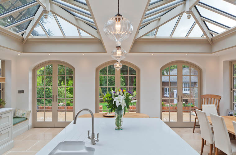 Light filled kitchen and dining orangery on a listed for Orangery lighting ideas