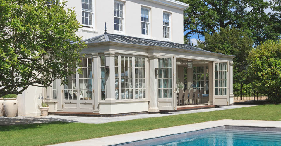 Georgian conservatory with bi-fold doors open the home to the garden