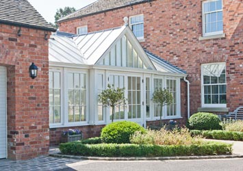 Traditional conservatory linking the main house to the garage.