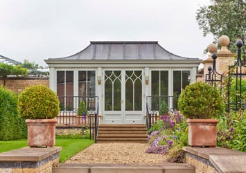Freestanding traditional conservatory with lead roof.