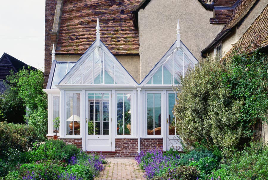 Multi-Gabled glasshouse conservatory with steep roof pitches