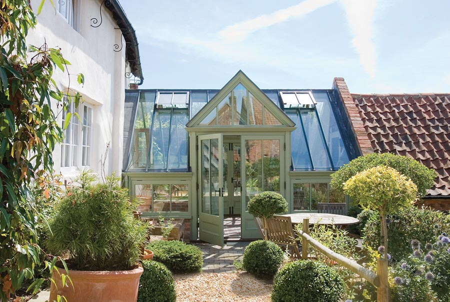 Small linking conservatory provide a great solution for an awkward space