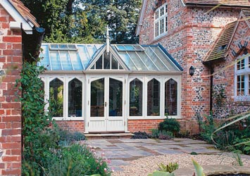 Conservatory connects the house to converted outbuildings.
