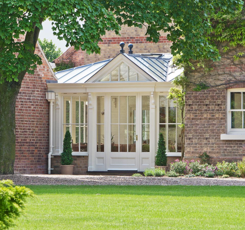 Conservatory used to link buildings and extend the existing living space