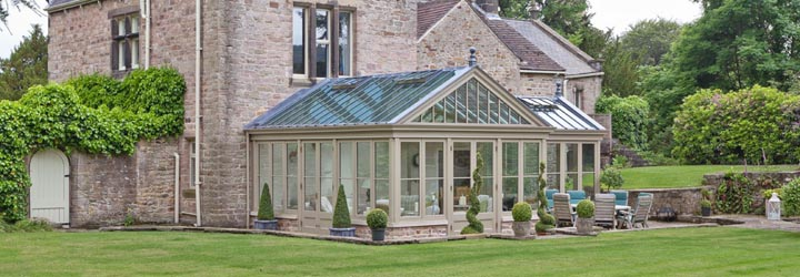 Large conservatory designed to blend harmoniously with the main house.