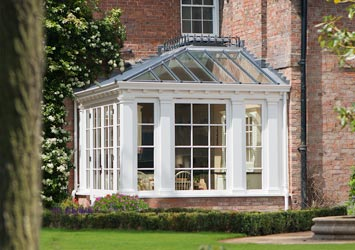 Farmhouse kitchen conservatory extension for dining and linking to the garden.