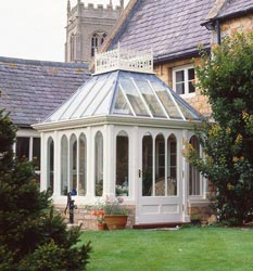A small pretty conservatory traditionally designed to complement the house.