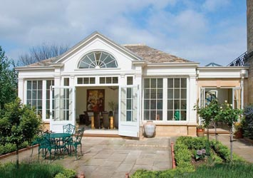Conservatory with stone tiled roof to match the main house.