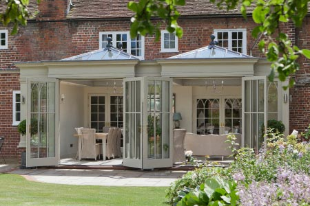 Double doors open this unusual orangery design onto beautiful gardens in Kent
