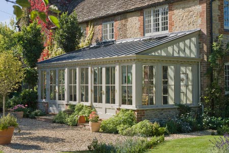 Traditional Lean to provides a simple yet stylish solution to this country home