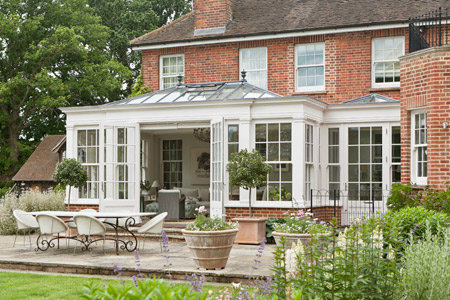 An Orangery in two parts. An elegant room with double doors with a separate side entrance into the home.