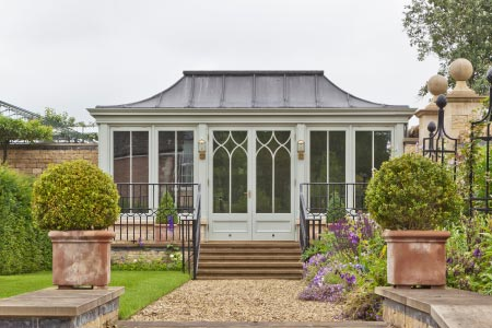 A free standing garden room with curved lead roof overlooks beautiful gardens in Rutland