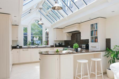 This kitchen conservatory with a decorative gable end creates a functional link for this property in Warwickshire