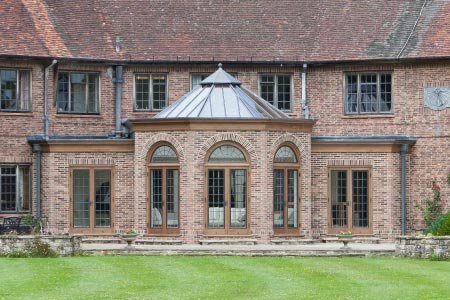 Vale's ability to maintain architectural integrity can be seen in the orangery linking three rooms of this property in East Sussex