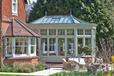 Traditional bay fronted Edwardian conservatory with bifold doors in Surrey