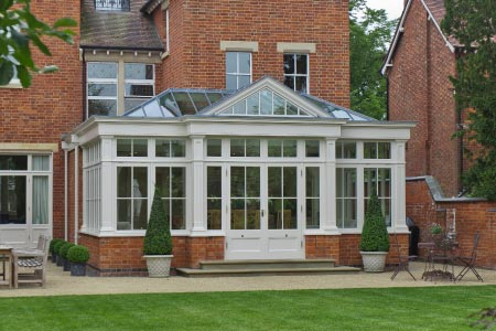 Open plan kitchen conservatory extends an Edwardian Warwickshire townhouse