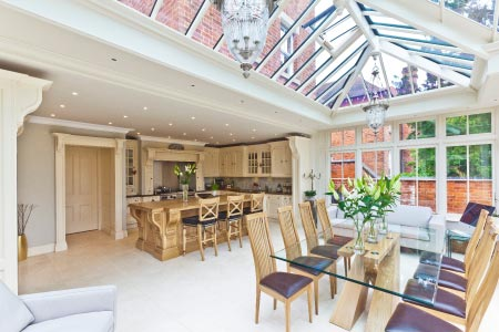 Open plan kitchen conservatory extends an Edwardian Warwickshire townhouse