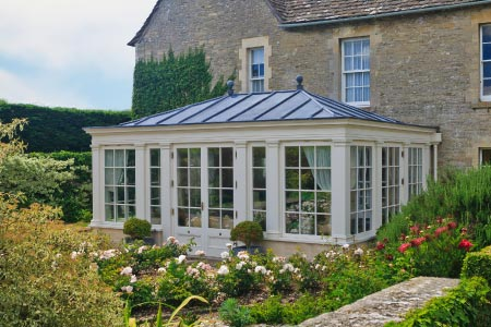 The fully insulated lead roof to this orangery in Gloucester provides a comfortable living space all year round