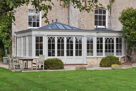 A Georgian orangery with a lead roof adds character to a Wiltshire period property