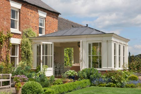 The margin detail to the windows of this orangery in Leicestershire matches the existing glazing on the property