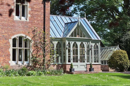 Victorian conservatory in Lincolnshire mirrors the high pitched roofs of the Rectory