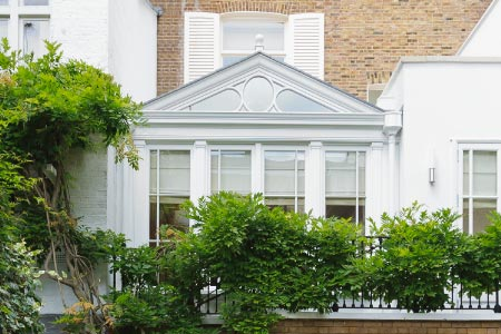 A sophisticated office is created with a first floor conservatory addition on a London property