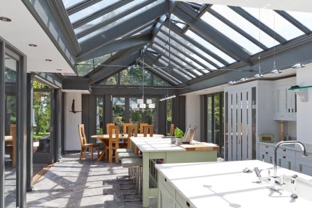 A modern airy kitchen extension provides a contrast with other rooms in this period home