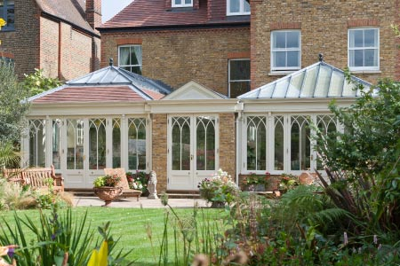 Unusual open plan conservatory provides a kitchen, dining and living area to a North London home