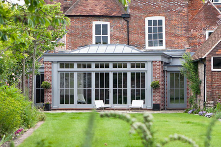 Home living space extended with an open plan orangery with multi folding doors.