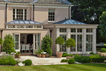 Orangery on a Georgian home in Nottinghamshire features full height panels and folding doors