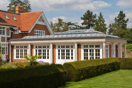 An orangery in Buckinghamshire combines elements of a solid lead roof construction with two glazed lanterns