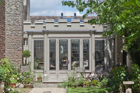 An unusual bespoke conservatory addition in Somerset creates a valuable open plan kitchen and dining area