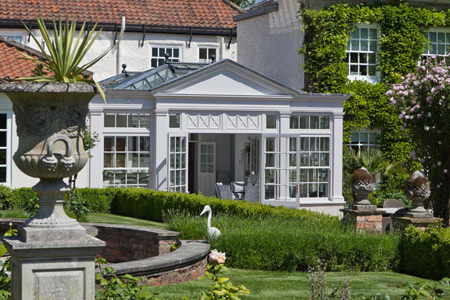 Twin roof lantern orangery homes a luxury kitchen with areas for dining and entertaining space.
