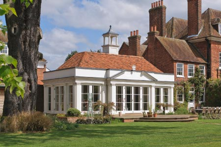 A magnificent Georgian orangery is a befitting structure for this substantial home in Buckinghamshire