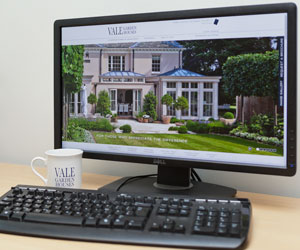 Computer with ale Garden Houses website